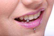 Cómo tener una sonrisa más brillante con un piercing dental