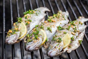 Ilustración de Cómo Cocinar Pescado a la Parrilla