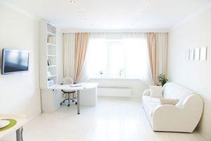 Cómo agrandar espacios con cortinas