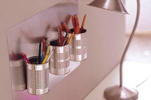Ideas para reutilizar latas de conserva. Como hacer organizadores y maceteros con latas de conserva. Un organizador con latas de conserva.